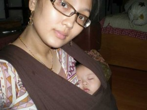 Mommy Eva wearing Sleepy Wrap